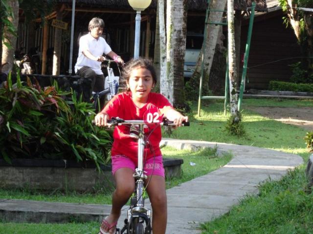 Mita & her father enjoy bike riding