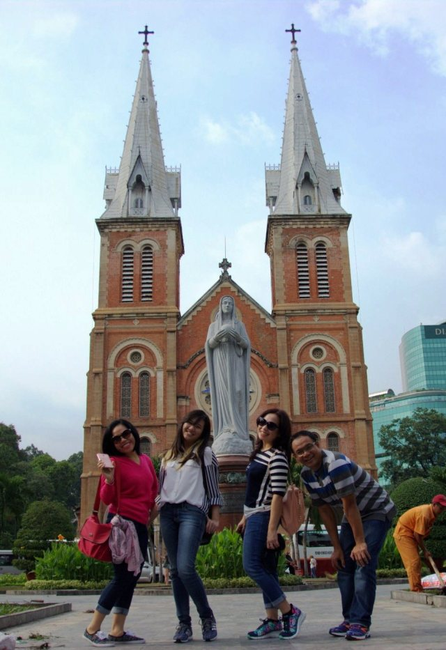 just four of us in front of Notre-Dame Basilica of Saigon