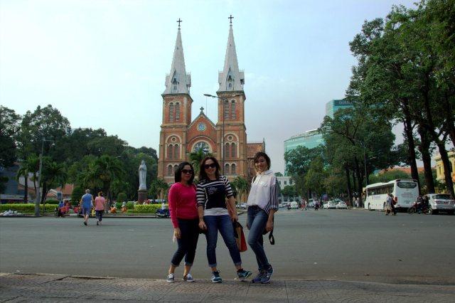 taking photo accros the street of Notre-Dame Basilica of Saigon